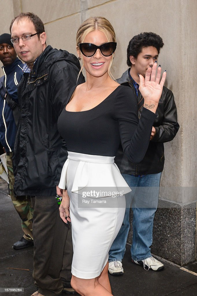 Actress Carmen Electra leaves the 'Today Show' taping at the NBC Rockefeller Center Studios on December 4, 2012 in New York City.