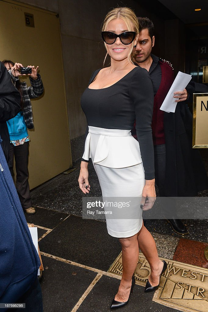 Actress <a gi-track='captionPersonalityLinkClicked' href=/galleries/search?phrase=Carmen+Electra&family=editorial&specificpeople=171242 ng-click='$event.stopPropagation()'>Carmen Electra</a> leaves the 'Today Show' taping at the NBC Rockefeller Center Studios on December 4, 2012 in New York City.