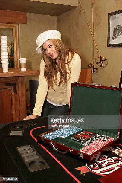 Actress Carmen Electra visits the Michelob Amber Bock World Poker Tour display at the Gibson Gift Lounge during the 2005 Sundance Film Festival on...