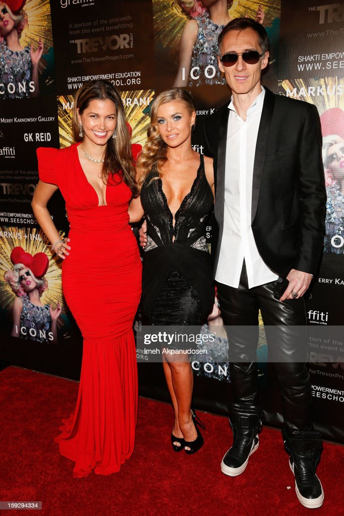 Actress <a gi-track='captionPersonalityLinkClicked' href=/galleries/search?phrase=Carmen+Electra&family=editorial&specificpeople=171242 ng-click='$event.stopPropagation()'>Carmen Electra</a> (C) with photographers Indrani (L) and Markus Klinko (R) attend the Markus + Indrani ICONS Book Launch Party at Merry Karnowsky Gallery on January 10, 2013 in Los Angeles, California.