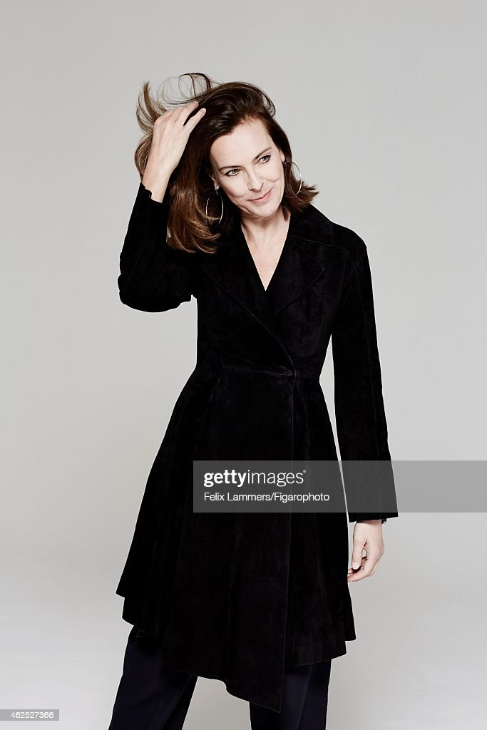 Actress <a gi-track='captionPersonalityLinkClicked' href=/galleries/search?phrase=Carole+Bouquet&family=editorial&specificpeople=208685 ng-click='$event.stopPropagation()'>Carole Bouquet</a> is photographed for Madame Figaro on December 22, 2014 in Paris, France. Coat (Dior), earrings (Hermès).