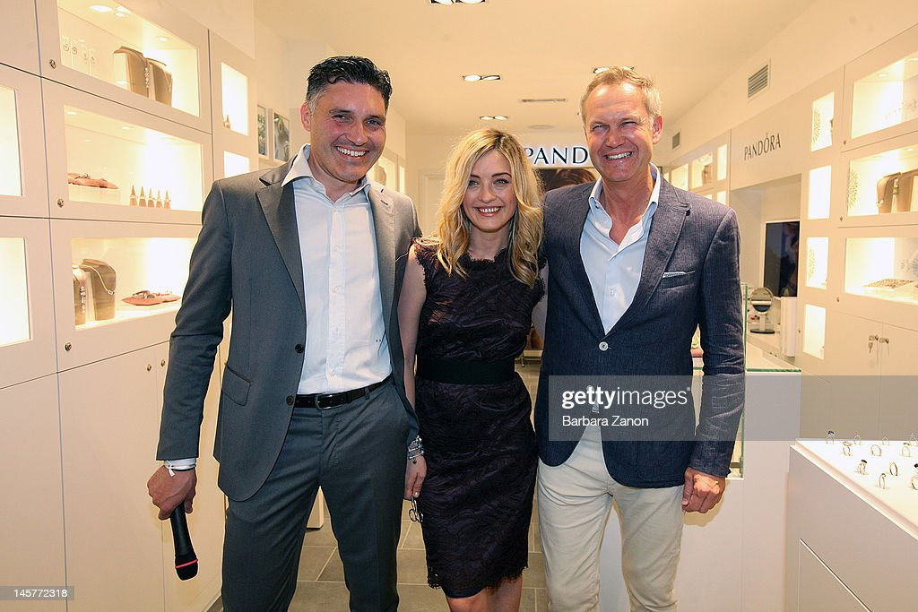 Actress Carolina Crescentini with managing director Peter Mark and general director Massimo Basei attend the opening of Pandora Gioielli Store at...