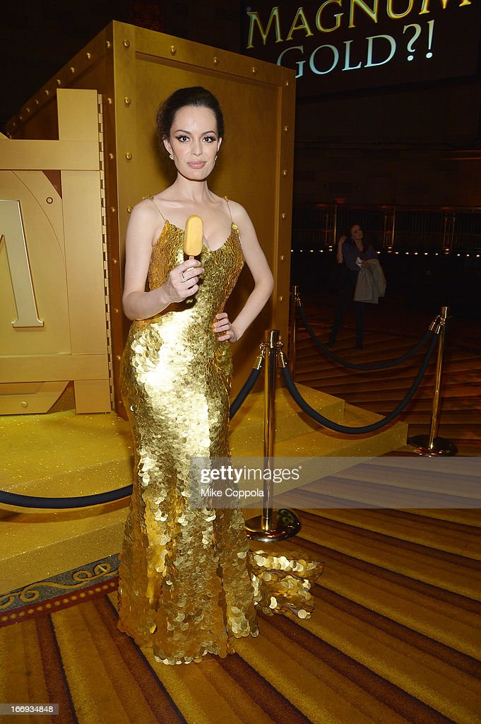 Actress Caroline Correa indulges in a MAGNUM Gold?! bar at the 'As Good As Gold' MAGNUM Gold?! Film Premiere on April 18, 2013 in New York City.