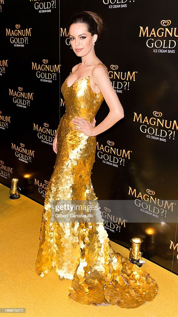 Actress Caroline Correa poses wearing a Zac Posen one-of-a-kind 24k gold dress valued at $1.5 million at the premiere of 'As Good As Gold' during the 2013 Tribeca Film Festival at Gotham Hall on April 18, 2013 in New York City.