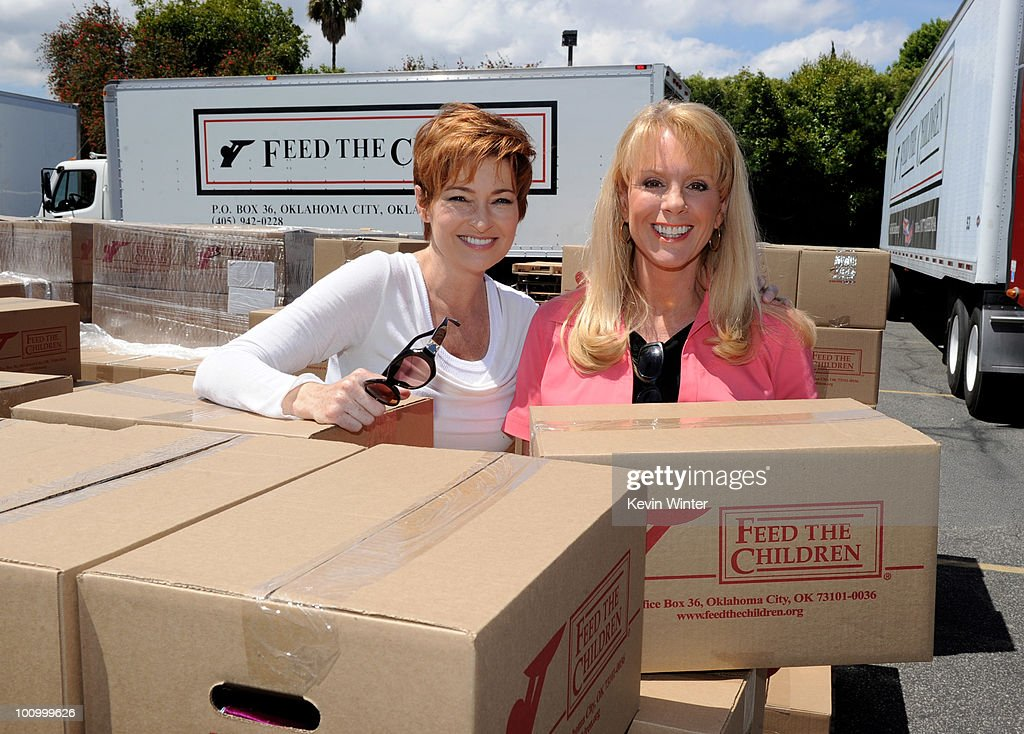 Actress Carolyn Hennesy (L) and TV personality Laura McKenzie help distribute food at the 37th Annual Daytime Emmy Awards' 'Daytime Gives Back' at the Salvation Army on May, 26, 2010 in Van Nuys, California.