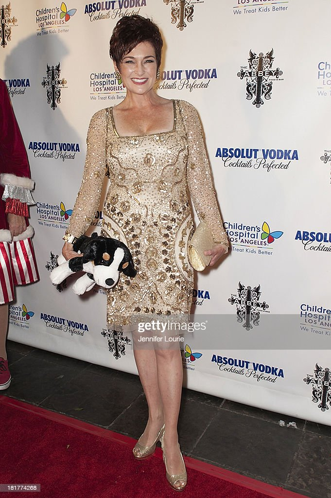Actress <a gi-track='captionPersonalityLinkClicked' href=/galleries/search?phrase=Carolyn+Hennesy&family=editorial&specificpeople=4583821 ng-click='$event.stopPropagation()'>Carolyn Hennesy</a> attends The Abbey's 8th Annual Christmas in September event benefiting The Children's Hospital Los Angeles at The Abbey on September 24, 2013 in West Hollywood, California.