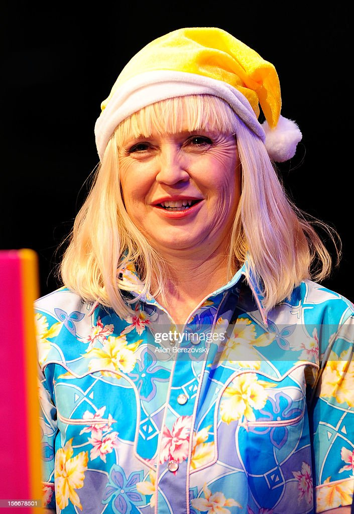 Actress Carolyn Lawrence, the voice of Sandy Cheeks, performs during 'Spongebob Holiday Extravapants' very special live concert performance hosted by Nickelodeon at The Grove on November 18, 2012 in Los Angeles, California.