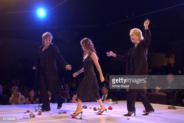 Actress Carrie Fischer with her daughter and mother Debbie Reynolds walks on stage during the 2nd Annual 'Runway for Life' celebrity fashion show...