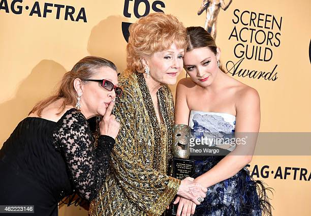 Actress Carrie Fisher actress Debbie Reynolds and actress Billie Lourd pose in the press room at TNT's 21st Annual Screen Actors Guild Awards at The...