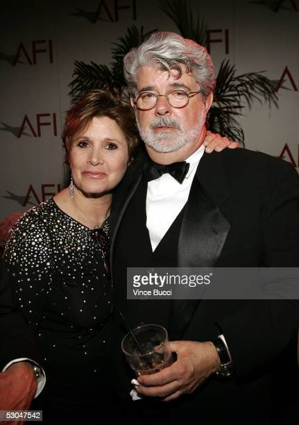 Actress Carrie Fisher and director George Lucas pose at the 33rd AFI Life Achievement Award after party at the Highlands on June 9 2005 in Hollywood...