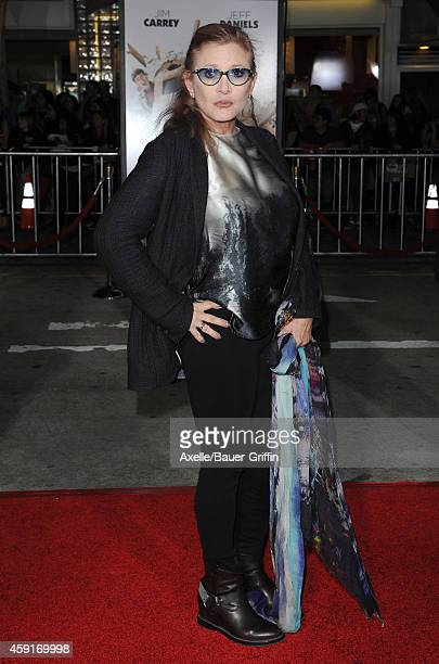 Actress Carrie Fisher arrives at the Los Angeles premiere of 'Dumb And Dumber To' at Regency Village Theatre on November 3 2014 in Westwood California