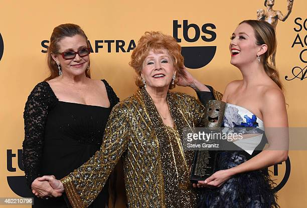 Actress Carrie Fisher honoree Debbie Reynolds and Billie Lourd pose in the press room at the 21st Annual Screen Actors Guild Awards at The Shrine...