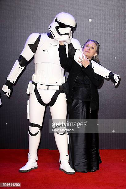 Actress Carrie Fisher poses with a Stormtrooper as she attends the European Premiere of 'Star Wars The Force Awakens' at Leicester Square on December...