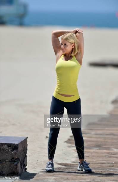 Actress Carrie Keagan enjoys a day at the beach in Santa Monica on August 13 2013 in Los Angeles California