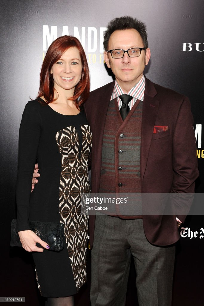 Actress <a gi-track='captionPersonalityLinkClicked' href=/galleries/search?phrase=Carrie+Preston&family=editorial&specificpeople=2220324 ng-click='$event.stopPropagation()'>Carrie Preston</a> (L) and actor <a gi-track='captionPersonalityLinkClicked' href=/galleries/search?phrase=Michael+Emerson&family=editorial&specificpeople=653299 ng-click='$event.stopPropagation()'>Michael Emerson</a> attend the screening of 'Mandela: Long Walk to Freedom', hosted by U2, Anna Wintour and Bob & Harvey Weinstein, with Burberry at the Ziegfeld Theater on November 25, 2013 in New York City.