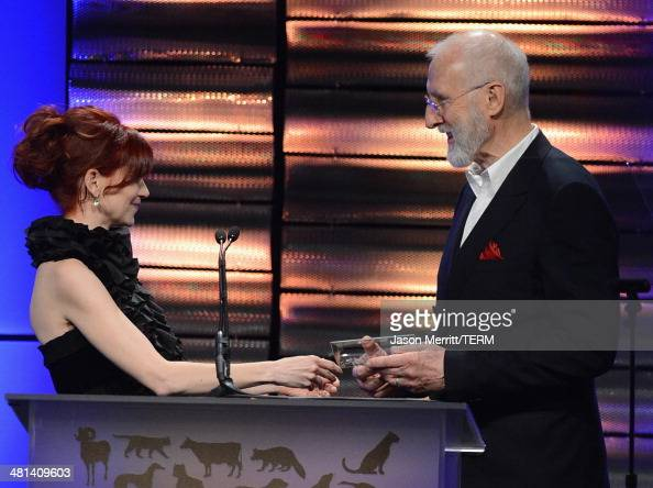 Actress Carrie Preston presents actor James Cromwell with the Lifetime Achievement Award at the Humane Society of The United States 60th Anniversary...