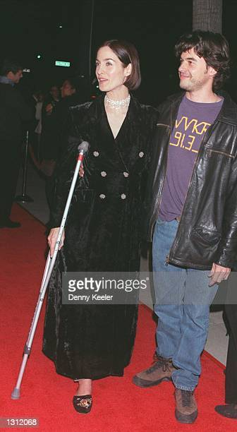 Actress CarrieAnne Moss and date attend the Los Angeles premiere of 'Chocolat' at The Academy of Motion Picture Arts and Sciences December 11 2000 in...