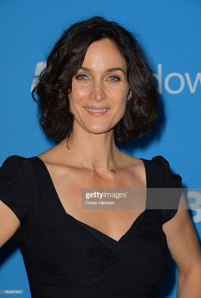 Actress Carrie-Anne Moss arrives at CBS 2012 fall premiere party held at Greystone Manor Supperclub on September 18, 2012 in West Hollywood, California.