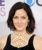 Actress CarrieAnne Moss arrives at the 2013 People's Choice Awards at Nokia Theatre LA Live on January 9 2013 in Los Angeles California