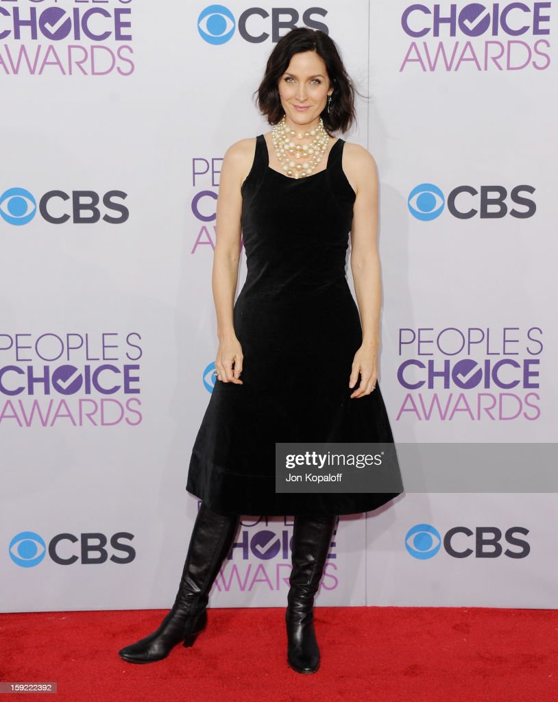 Actress Carrie-Anne Moss arrives at the 2013 People's Choice Awards at Nokia Theatre L.A. Live on January 9, 2013 in Los Angeles, California.