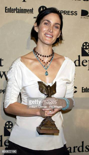 Actress CarrieAnne Moss with her Best Supporting Female award for Momento at the Independent Spirit Awards held in a tent on the Beach in Santa...
