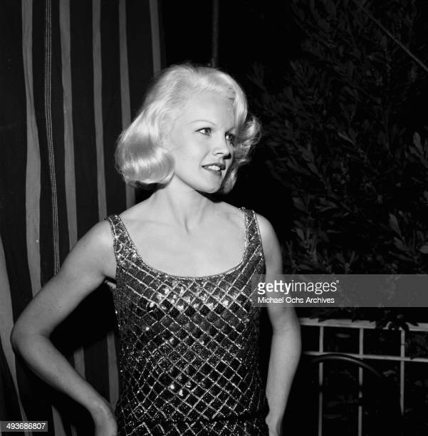 Actress Carroll Baker poses at the Cocoanut Grove in Los Angeles California
