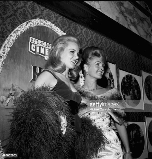 Actress Carroll Baker poses with actress Debbie Reynolds during the premier of 'How the West Was Won' in Los Angeles California
