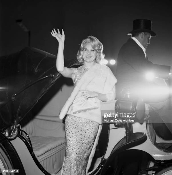 Actress Carroll Baker waves to a crowd in Los Angeles California