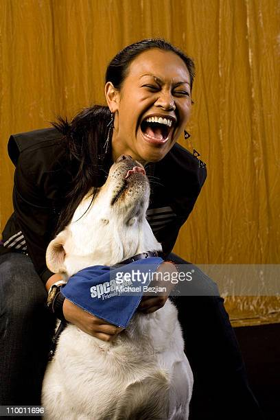 Actress Cassandra Hepburn poses with dog at the Main Event Red Carpet Lounge and Green Suite on February 21 2008 in Los Angeles CA