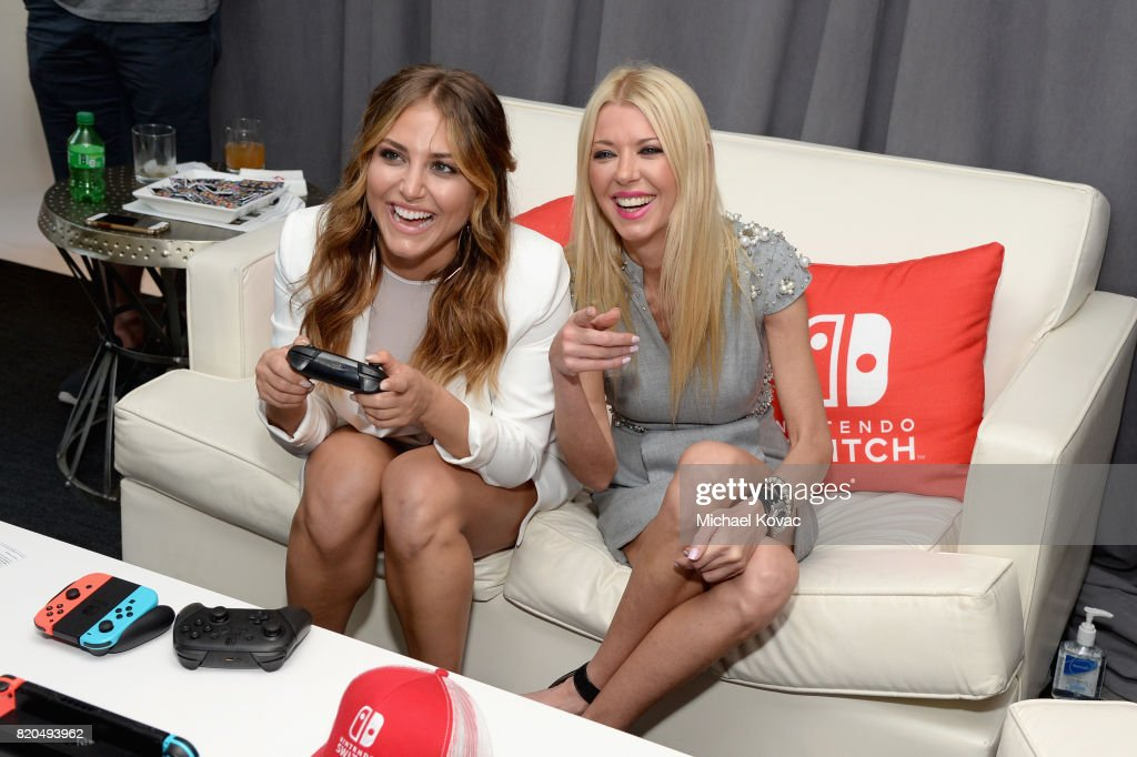 Actress Cassie Scerbo and actress Tara Reid from movie 'Sharknado 5' stopped by Nintendo at the TV Insider Lounge to check out Nintendo Switch during Comic-Con International at Hard Rock Hotel San Diego on July 21, 2017 in San Diego, California.