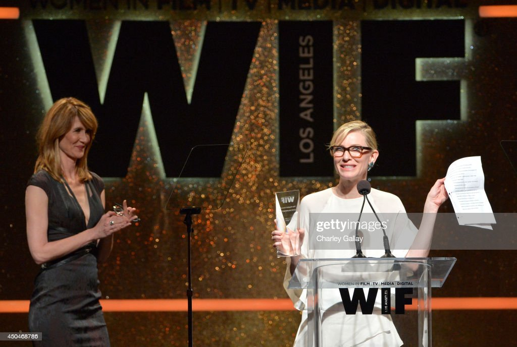 Actress <a gi-track='captionPersonalityLinkClicked' href=/galleries/search?phrase=Cate+Blanchett&family=editorial&specificpeople=201621 ng-click='$event.stopPropagation()'>Cate Blanchett</a> (R) accepts the Crystal Award for Excellence in Film onstage as actress <a gi-track='captionPersonalityLinkClicked' href=/galleries/search?phrase=Laura+Dern&family=editorial&specificpeople=204203 ng-click='$event.stopPropagation()'>Laura Dern</a> (L) looks on at Women In Film 2014 Crystal + Lucy Awards presented by MaxMara, BMW, Perrier-Jouet and South Coast Plaza held at the Hyatt Regency Century Plaza on June 11, 2014 in Los Angeles, California.