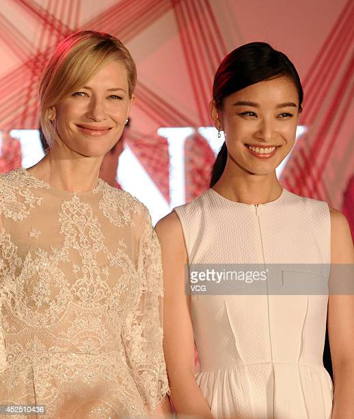 Actress Cate Blanchett and actress Ni Ni attend a commercial activity on July 22 2014 in Shanghai China