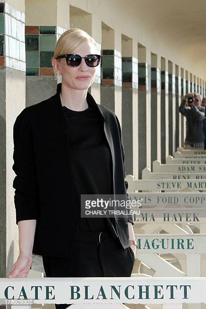 US actress Cate Blanchett stands next to her dedicated beach locker room on the Promenade des Planches on August 31 2013 in the French northwestern...