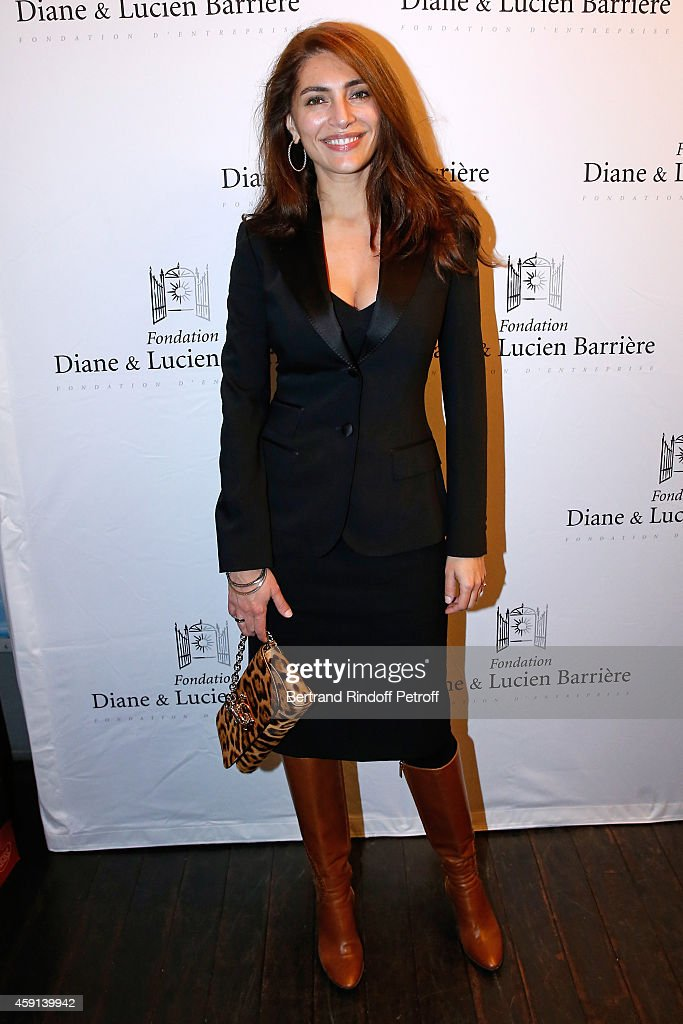 Actress <a gi-track='captionPersonalityLinkClicked' href=/galleries/search?phrase=Caterina+Murino&family=editorial&specificpeople=619334 ng-click='$event.stopPropagation()'>Caterina Murino</a> attends 'Les Heritiers' receives Cinema Award 2014 of Foundation Diane & Lucien Barriere during the premiere of the movie at Publicis Champs Elysees on November 17, 2014 in Paris, France.