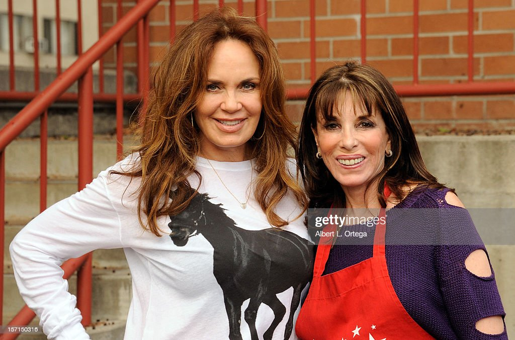 Actress Catherine Bach and actress Kate Linder participate in the Hollywood Chamber of Commerce's annual police and firefighters appreciation day at the Hollywood LAPD station on November 28, 2012 in Hollywood, California.