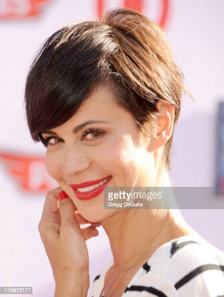 Actress Catherine Bell arrives at the Los Angeles premiere of 'Planes' at the El Capitan Theatre on August 5 2013 in Hollywood California
