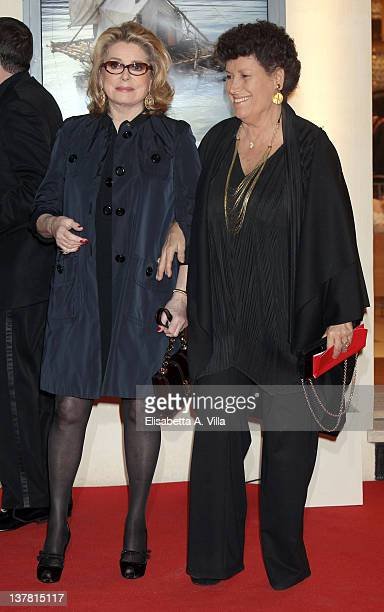 Actress Catherine Deneuve and Carla Fendi attends Maison Louis Vuitton Roma Etoile Cocktail Red Carpet on January 27 2012 in Rome Italy