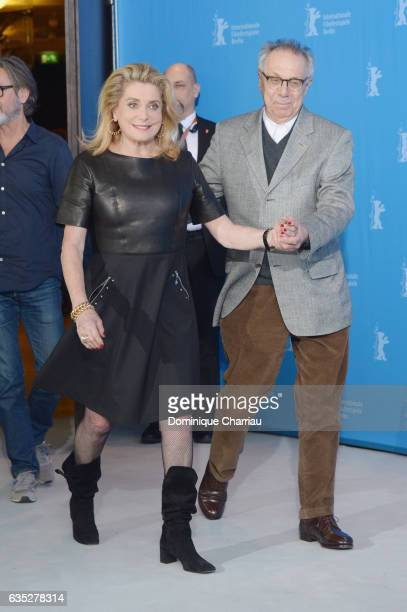 Actress Catherine Deneuve and Director of the festival Dieter Kosslick attend the 'The Midwife' photo call during the 67th Berlinale International...