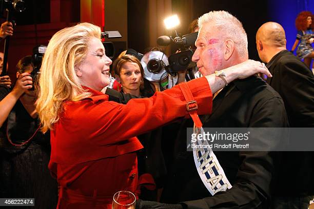 Actress Catherine Deneuve and Fashion designer Jean Paul Gaultier pose after the last Jean Paul Gaultier Womenswear show as part of the Paris Fashion...