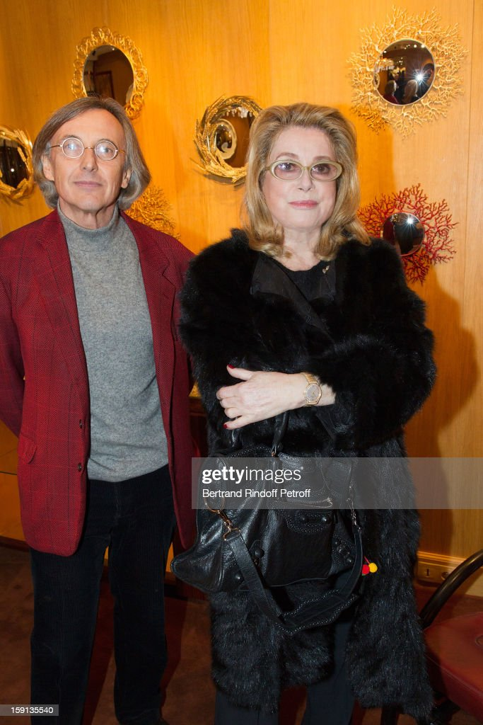 Actress <a gi-track='captionPersonalityLinkClicked' href=/galleries/search?phrase=Catherine+Deneuve&family=editorial&specificpeople=123833 ng-click='$event.stopPropagation()'>Catherine Deneuve</a> (R) and gallery owner Pierre Passebon attend the 'Sorcieres' (Witches) exhibition preview at Galerie Pierre Passebon on January 8, 2013 in Paris, France.