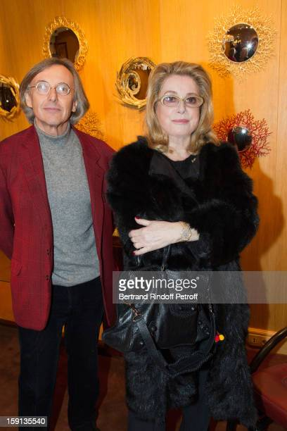 Actress Catherine Deneuve and gallery owner Pierre Passebon attend the 'Sorcieres' exhibition preview at Galerie Pierre Passebon on January 8 2013 in...