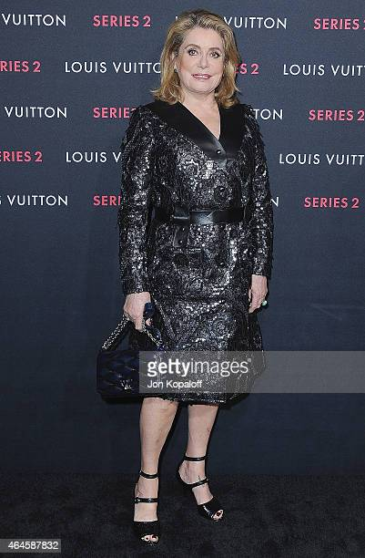 Actress Catherine Deneuve arrives at Louis Vuitton 'Series 2' The Exhibition on February 5 2015 in Hollywood California