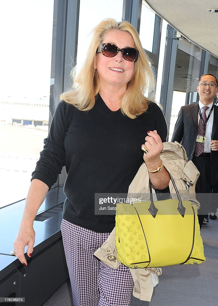 Actress <a gi-track='captionPersonalityLinkClicked' href=/galleries/search?phrase=Catherine+Deneuve&family=editorial&specificpeople=123833 ng-click='$event.stopPropagation()'>Catherine Deneuve</a> arrives at Narita International Airport on August 28, 2013 in Narita, Japan.