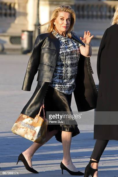 Actress Catherine Deneuve arrives at the Louis Vuitton's Dinner for the Launch of Bags by Artist Jeff Koons at Musee du Louvre on April 11 2017 in...