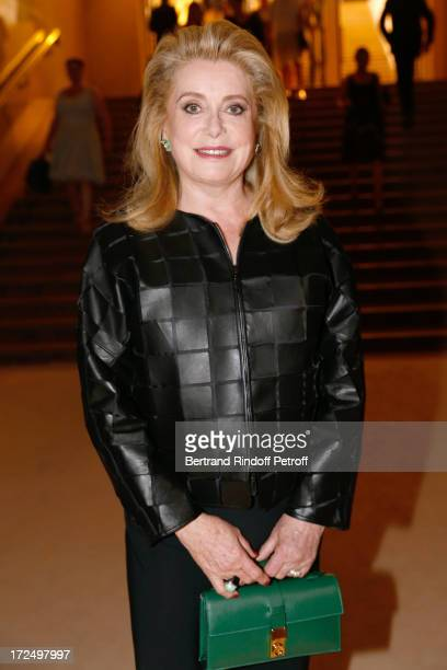 Actress Catherine Deneuve attends the Giorgio Armani Prive show as part of Paris Fashion Week HauteCouture Fall/Winter 20132014 at Theatre National...