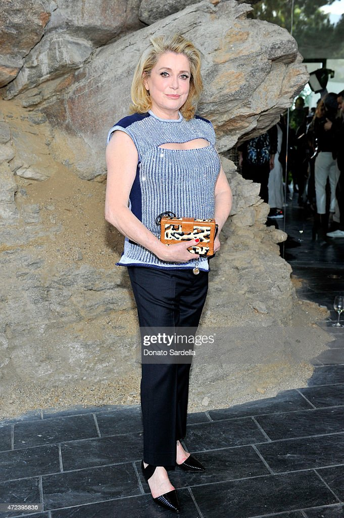 Actress <a gi-track='captionPersonalityLinkClicked' href=/galleries/search?phrase=Catherine+Deneuve&family=editorial&specificpeople=123833 ng-click='$event.stopPropagation()'>Catherine Deneuve</a> attends the Louis Vuitton Cruise 2016 Resort Collection shown at a private residence on May 6, 2015 in Palm Springs, California.