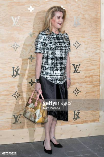 Actress Catherine Deneuve attends the 'Louis Vuitton Masters a collaboration with Jeff Koons' dinner at Musee du Louvre on April 11 2017 in Paris...