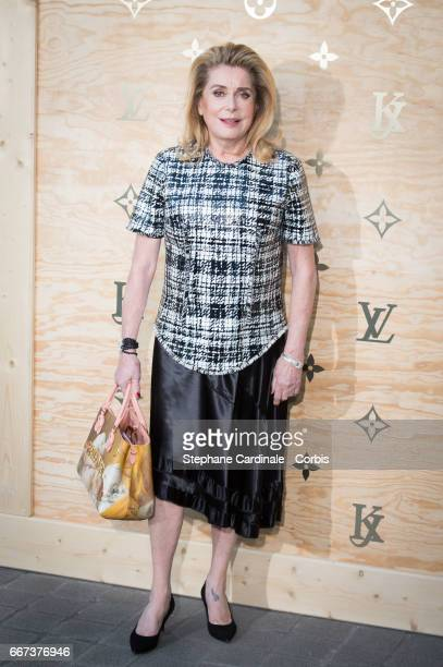Actress Catherine Deneuve attends the Louis Vuitton's Dinner for the Launch of Bags by Artist Jeff Koons at Musee du Louvre on April 11 2017 in Paris...