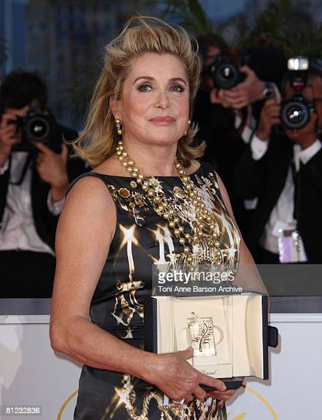 Actress Catherine Deneuve corecipient of the Special Prize for 61st Cannes poses at the Palme d'Or closing ceremony photocall at the Palais des...