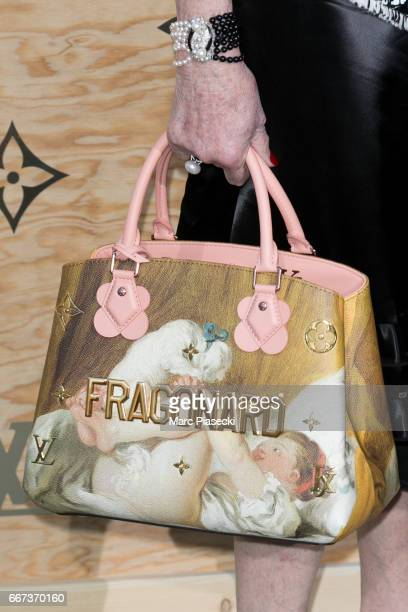 Actress Catherine Deneuve handbag detail attends the 'Louis Vuitton Masters a collaboration with Jeff Koons' dinner at Musee du Louvre on April 11...